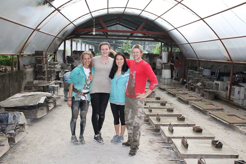 OSU students taking a break from pouring concrete into plancha molds.