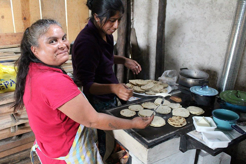 Local cooks preparing tortillas on the EcoPlancha during the Controlled Cooking Test