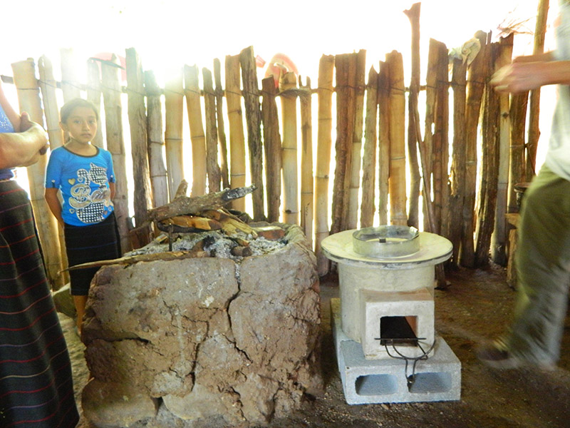 A family's traditional fire and their new Ecocina cookstove